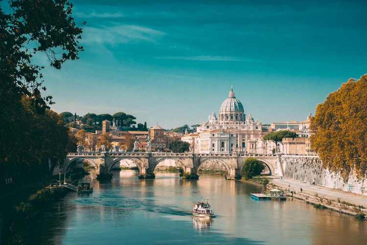 Small ship sailing on the River Tibur with view of St. Peter's Square and St. Peter's Basilica