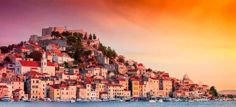 Sun setting over the old town of Sibenik in Croatia