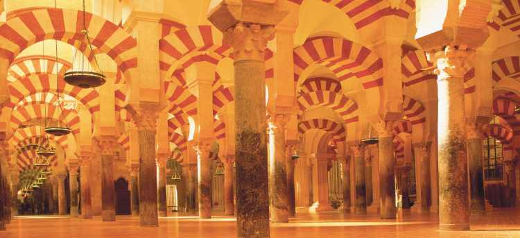 Striped arches and pillars inside the Mezquita Spain