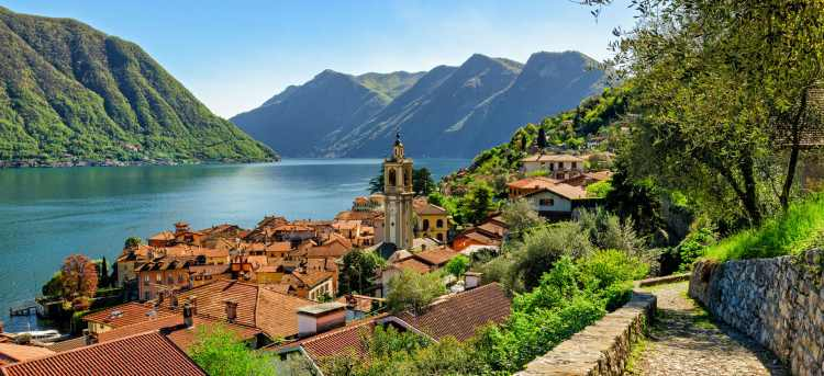 Lake Como rooftops bell tower and mountains   Late Availability: European Tours & City Breaks