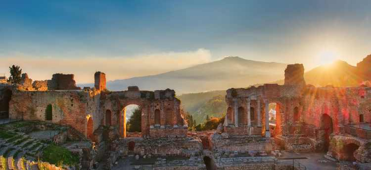 Ancient theatre of Taormina with sunrise over Etna volcano | Sicily, Italy | Solo Travellers