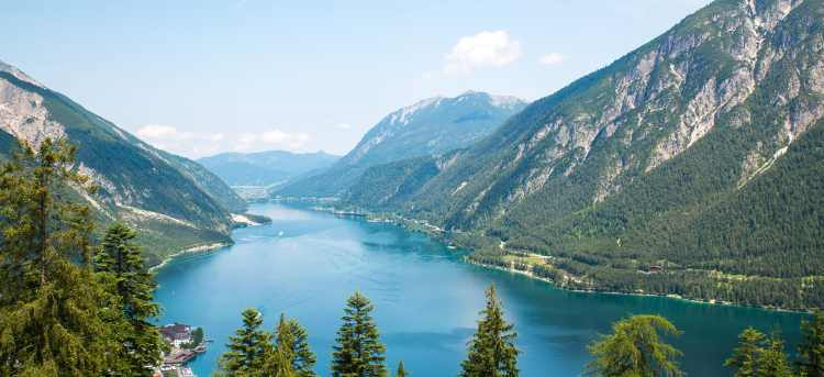Lake Achensee with blue water surrounded by mountains | Tyrol, Austria | Walk and Discover