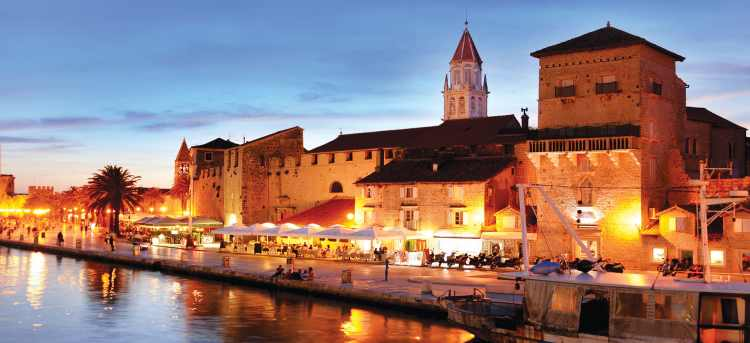 Trogir old town warm glow along waterfront in evening | Croatia | Riviera Travel | yacht cruise