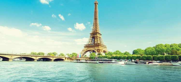 the eiffel tower along the seine river in paris