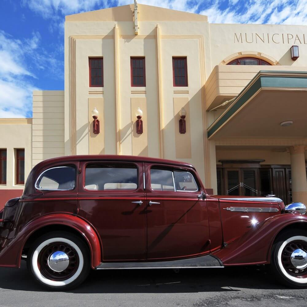 Art deco car and buildings in Napier