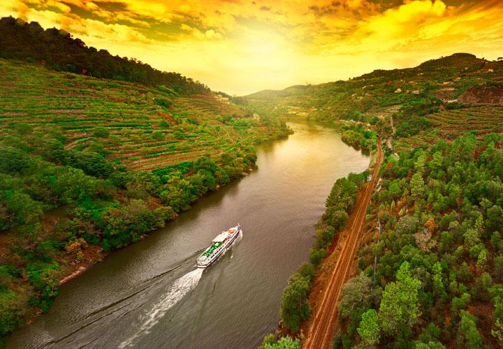 Cruising down the Douro Valley golden sky sunset