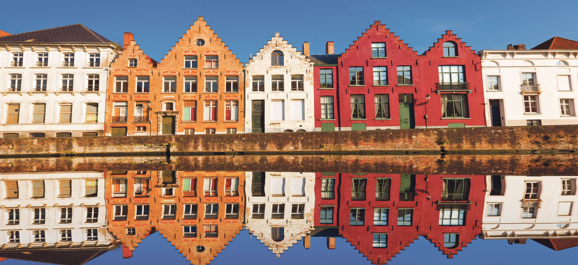 Traditional Belgian houses along canal in Bruges