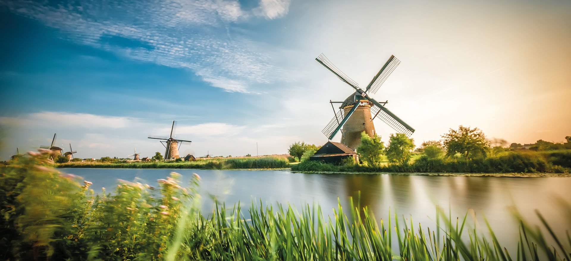 Traditional Dutch Windmill by the river