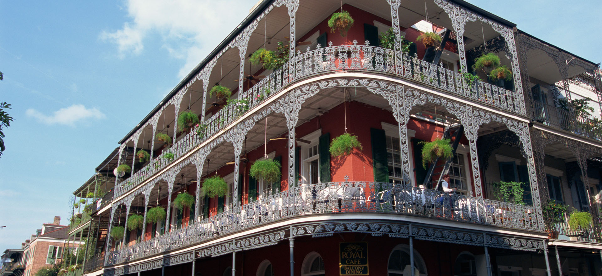 Typical French Quarter building with veranda and hanging plants in New Orleans, Louisiana