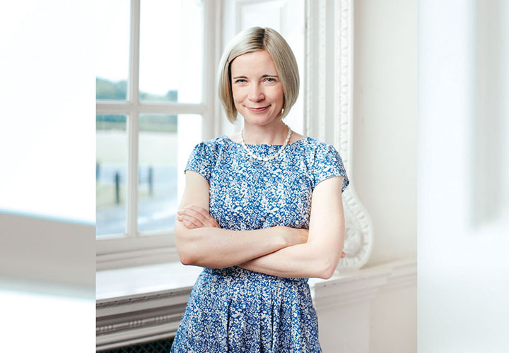 Lucy Worsley in blue dress by window