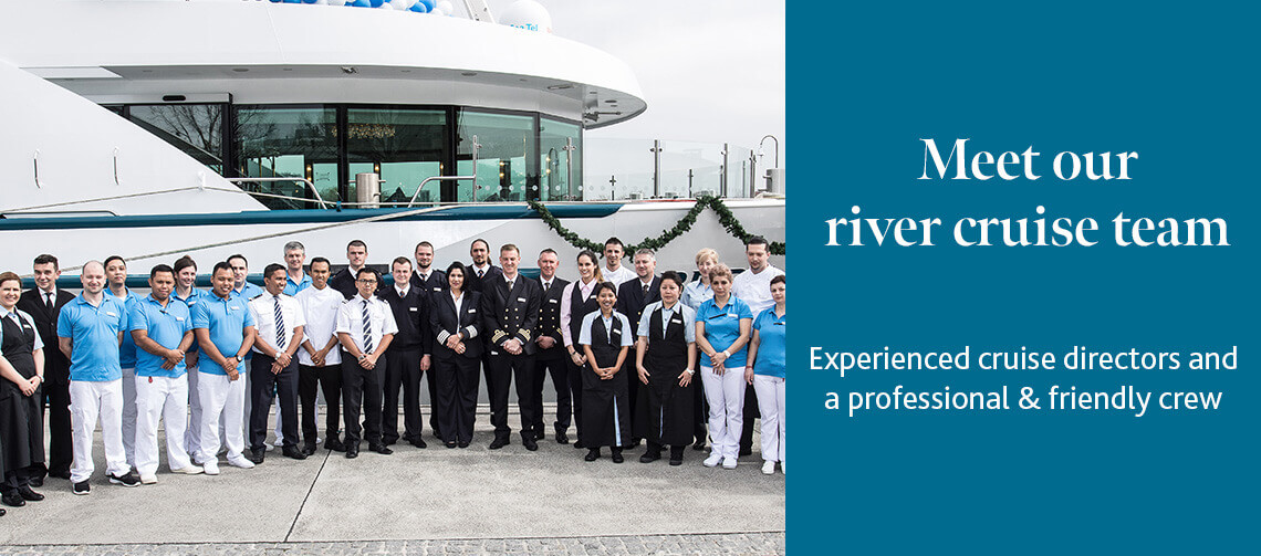 River cruise crew standing outside a ship