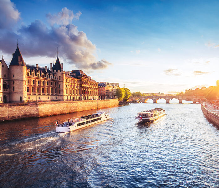 Ship cruising the Seine river in Paris | River Cruises in June 2019