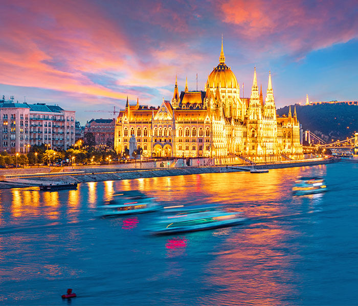 Hungarian Parliament Building in Budapest on the Danube River with Pink Sky | River Cruises in October 2019