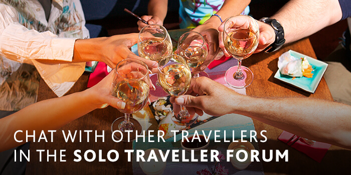 Group of friends clinking wine glasses | Riviera Travel Solo Traveller Forum