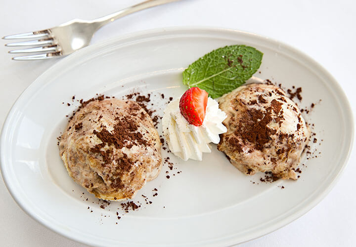 Chocolate sprinkled pudding with strawberry and fork