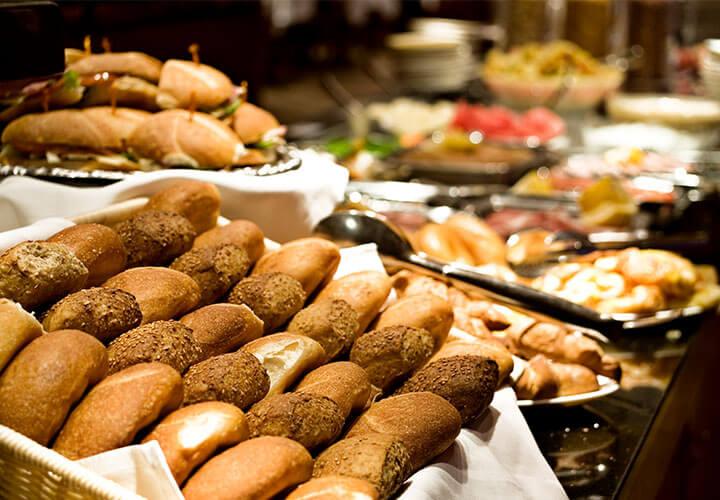 Basket of bread at breakfast buffet