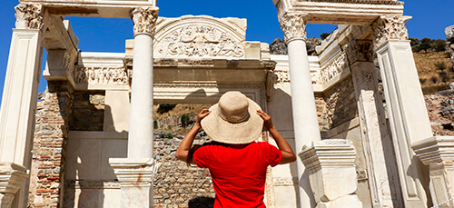 Woman looking at ancient ruins