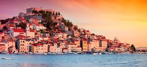 The sun setting over the old town of Sibenik in Croatia