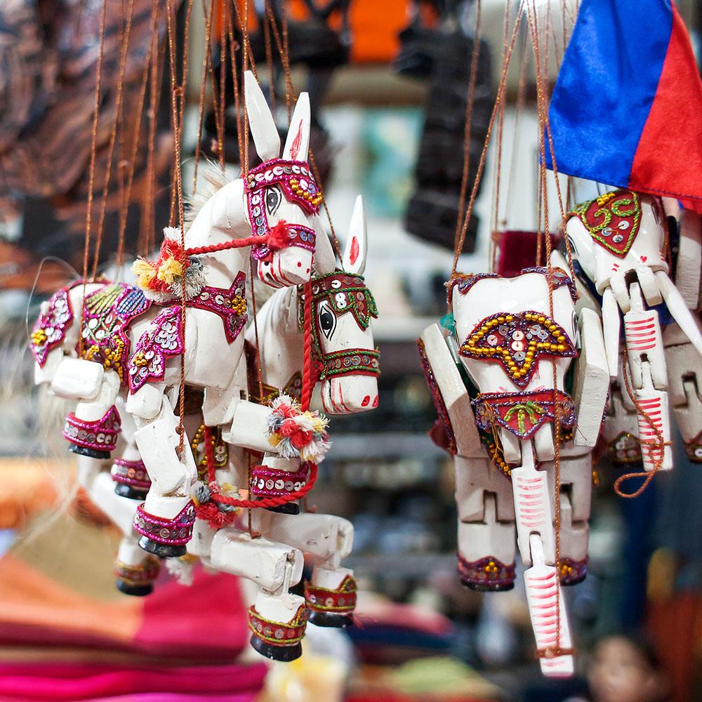 Wooden horse souvenirs at a Siem Reap market