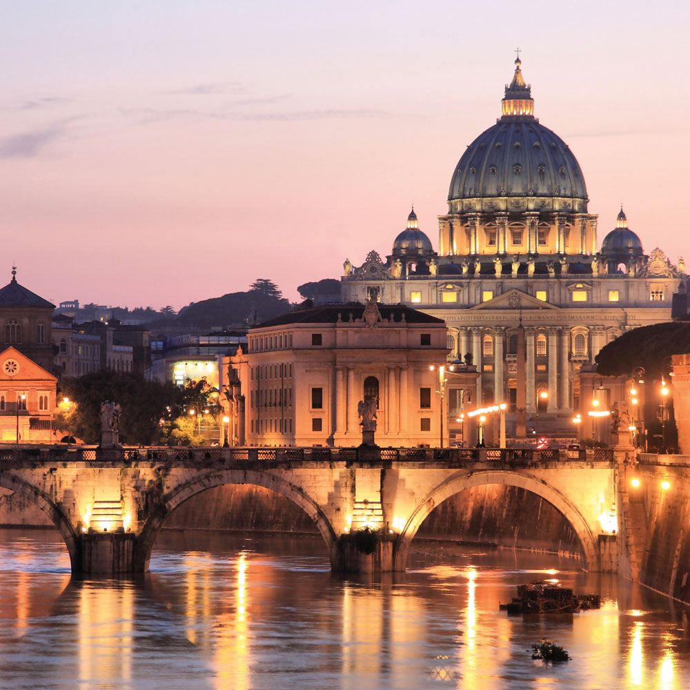 St Peter's Basilica by the river at sunset
