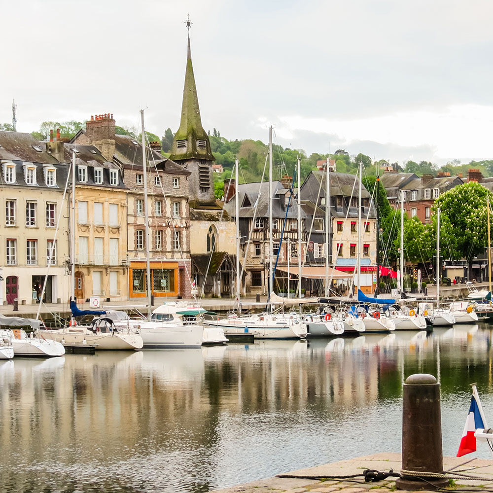 Row of boats moored in Honfleur's harbour