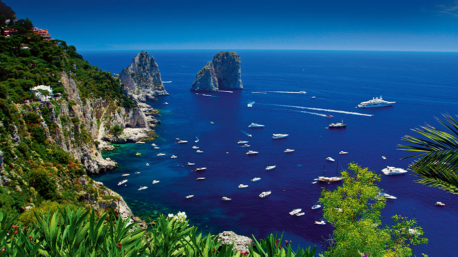 Faraglioni and boats around the Island of Capri