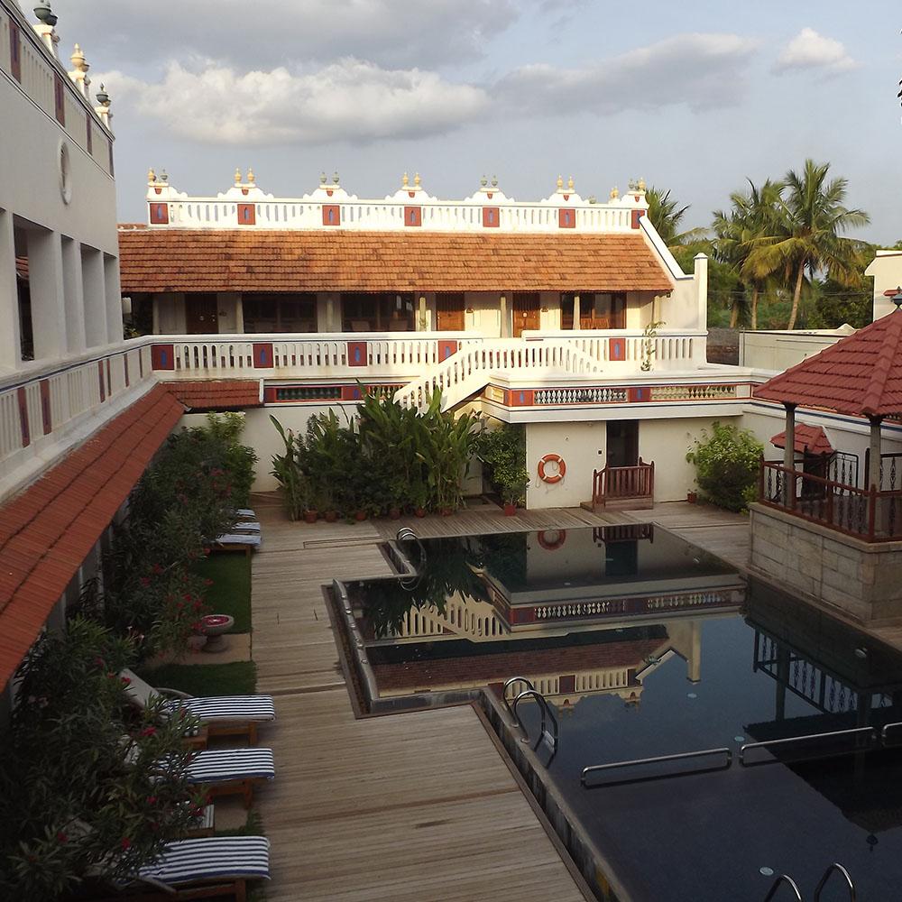 Relaxing pool area at the Chidambara Vilas
